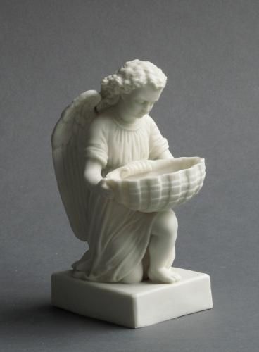 Parian ware angel and shell font