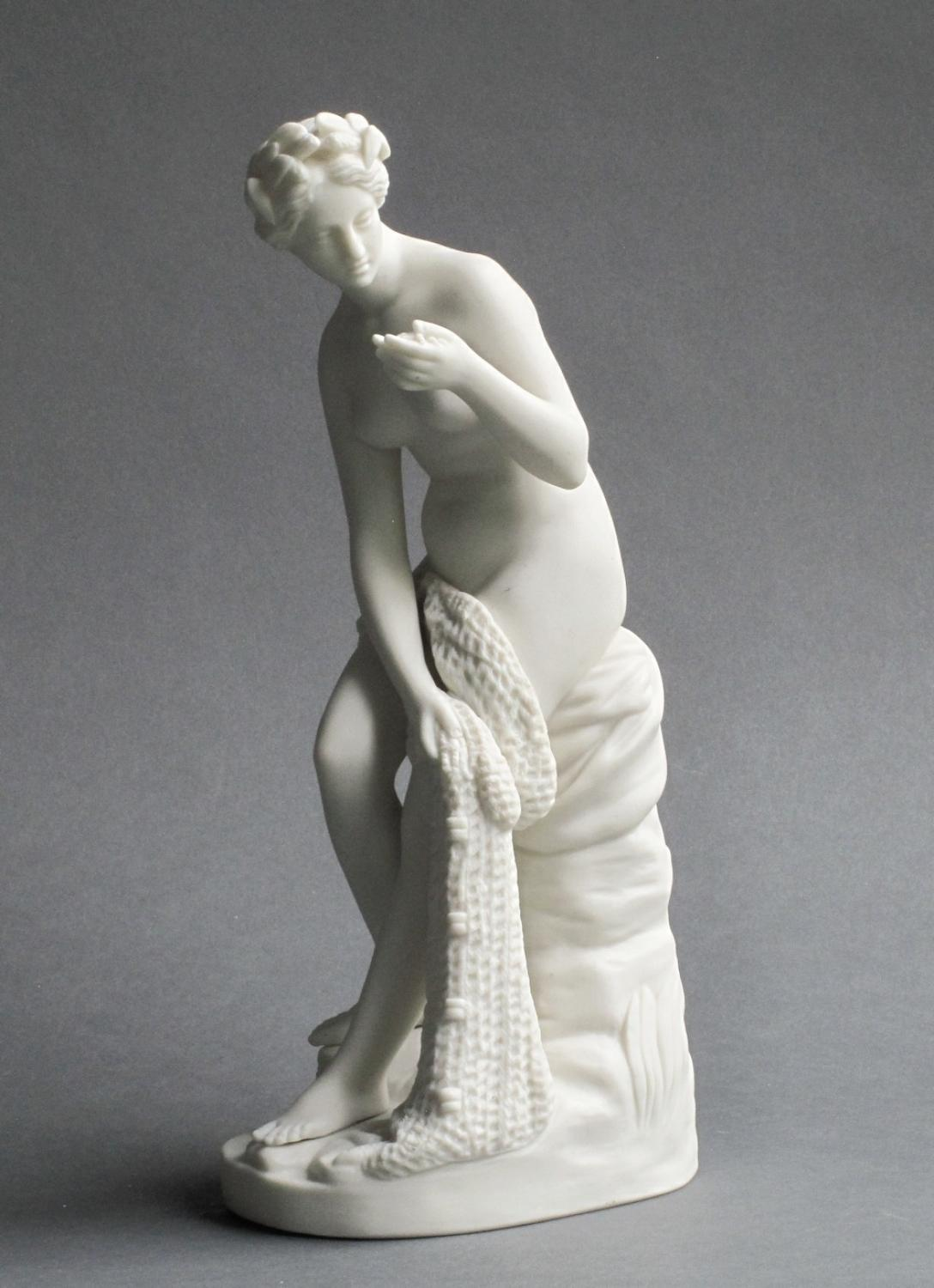 Figure of a woman with fishing net and shell