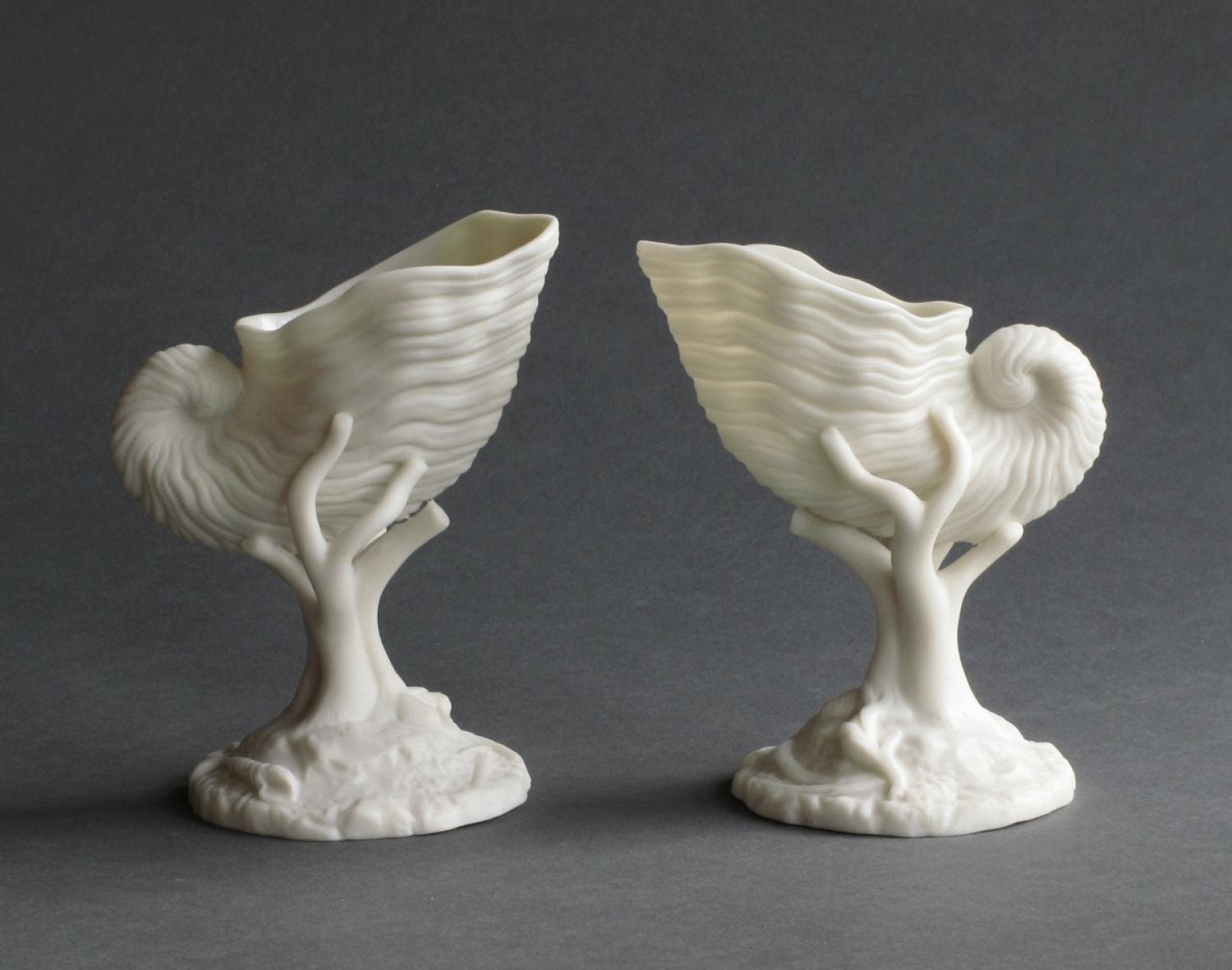 A pair of delicate shell form parian vases