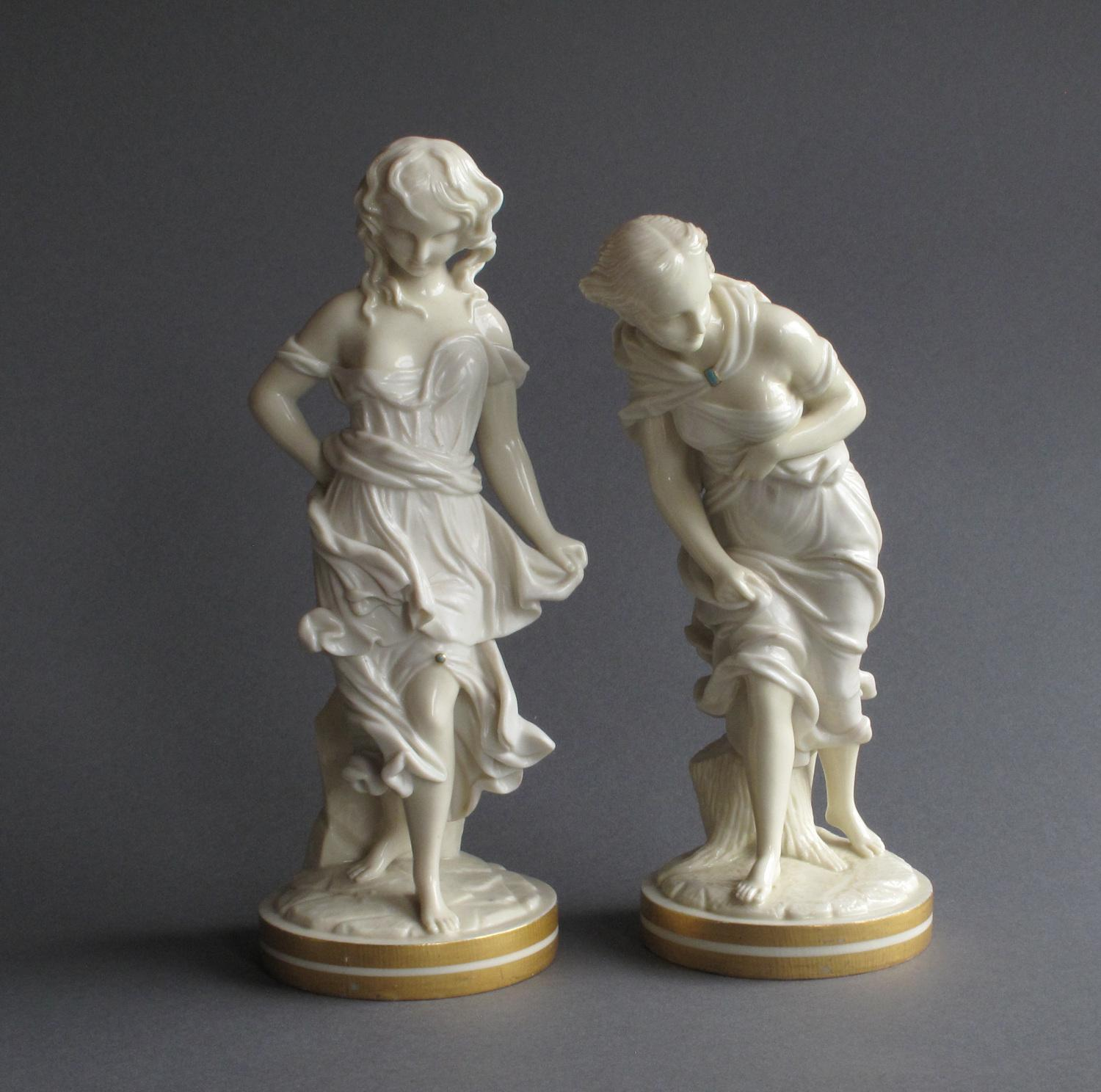 A pair of glazed Worcester Parian figures