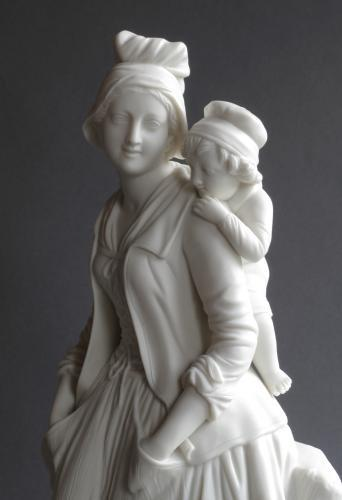 A Parian figure of a mother and child