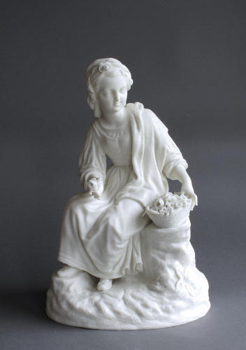 A Parian figure of a girl with flowers by R&L