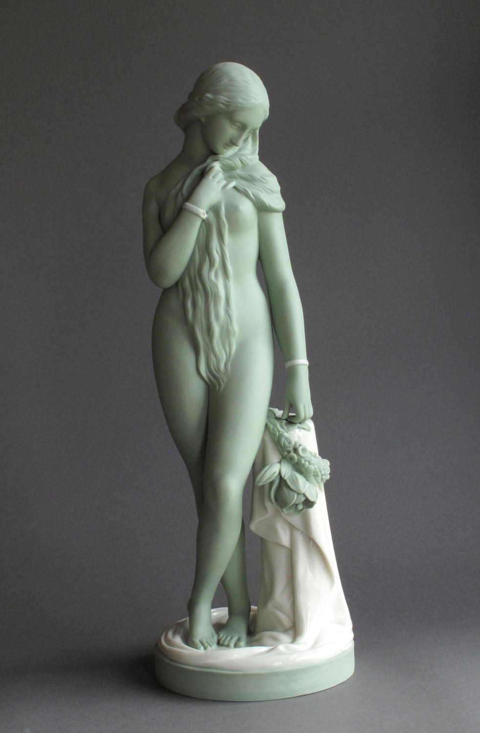 A Minton green and white glazed Parian figure of The Octoroon
