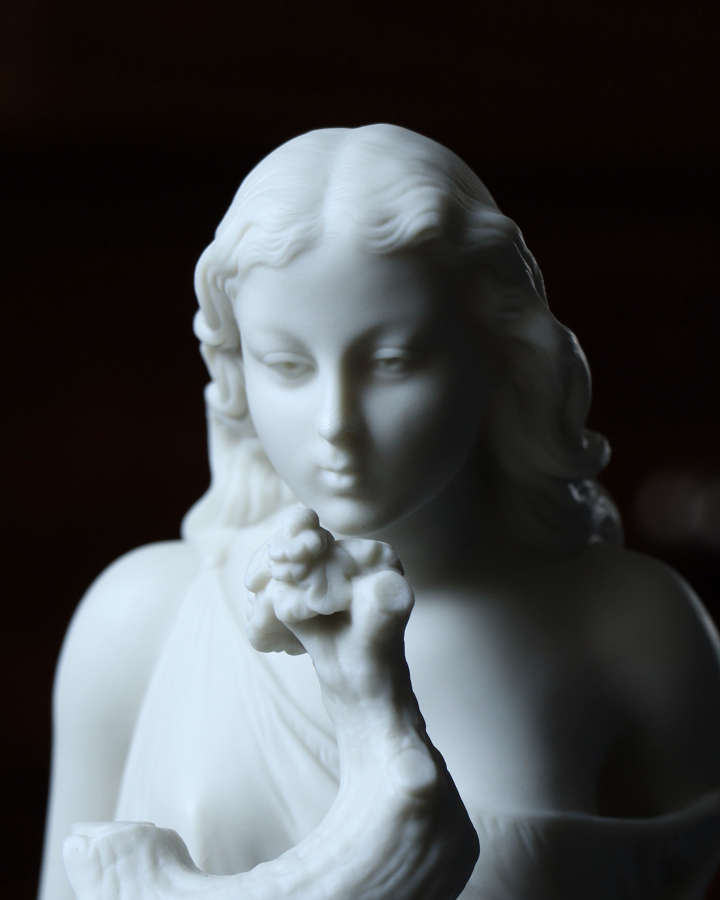 A Copeland Parian figure of a girl and a ladybird