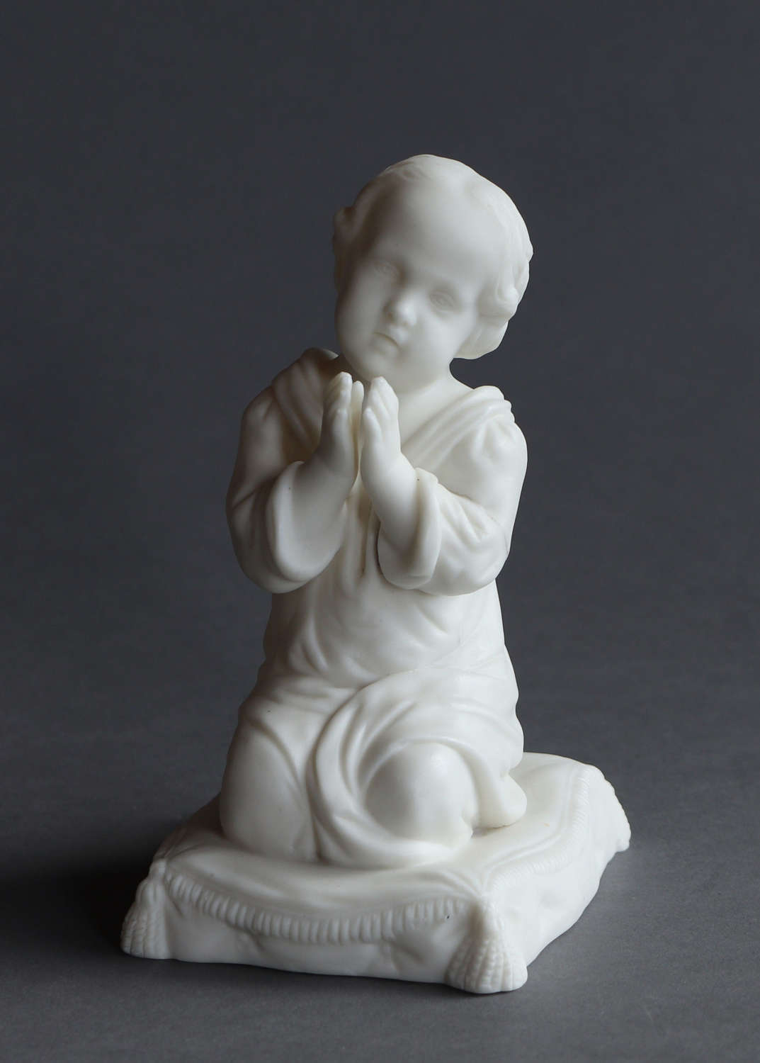 A small Parian figure of the infant Samuel