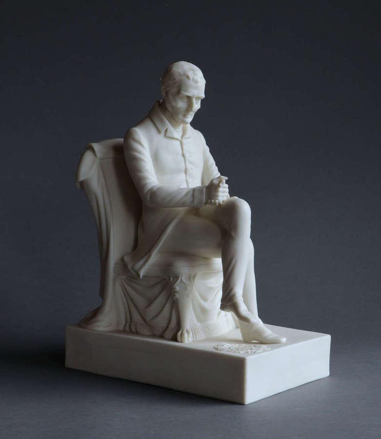 A Samuel Alcock Parian figure of the seated Duke of Wellington